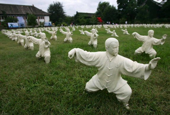 BEIJING, CHINA - AUGUST 1: (CHINA OUT) Sculptures of people performing Tai Chi are displayed at Peking University on August 1, 2008 in Beijing, China. A total of 600 sculptures have been placed on the campus to usher in the Olympic Games. Peking University Gymnasium is the table tennis venue for the 2008 Beijing Olympics. (Photo by China Photos/Getty Images)